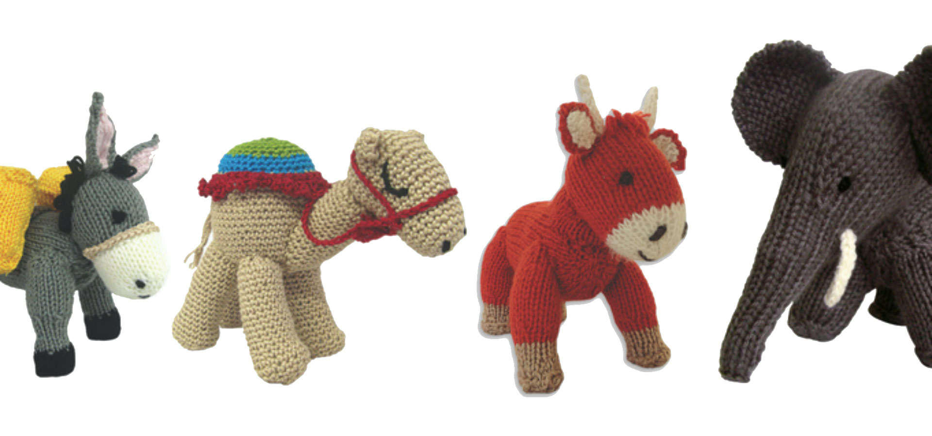 Animal knit toys on white background