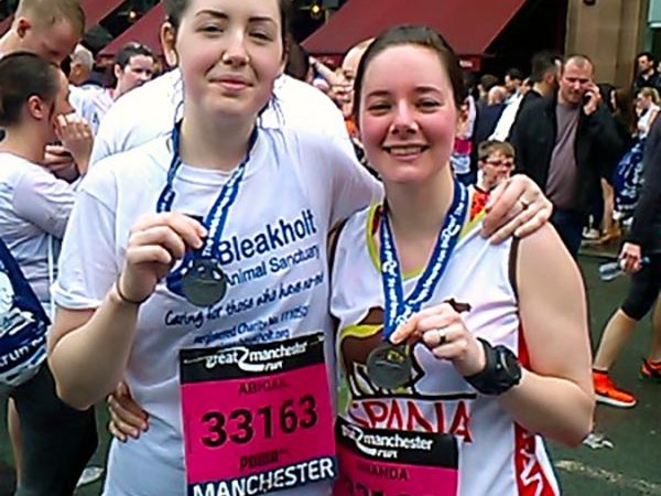 Amanda Bracewell and friend after Great Manchester Run holding medals